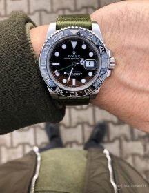 Rolex GMT Master II on green two piece NATO strap wristshot