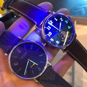 Nomos Ahoi Atlantic and Moser Pilot Tourbillon lume shot