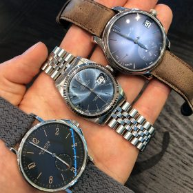 Shades of blue: Nomos Ahoi Atlantic, Rolex Datejust 16234, Moser Perpetual Calendar with different dials: matte, sunburst and fumé dial