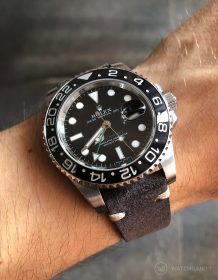 Rolex GMT Master II 116710LN on dark grey suede strap by WatchBandit