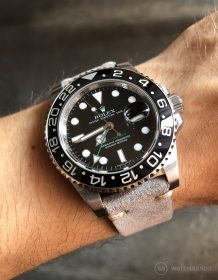 Rolex GMT Master II 116710LN on grey suede strap by WatchBandit