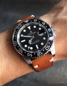 Rolex GMT Master II 116710LN on brown vintage leather strap by WatchBandit