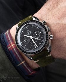 Omega Speedmaster on green Suede Strap by WatchBandit