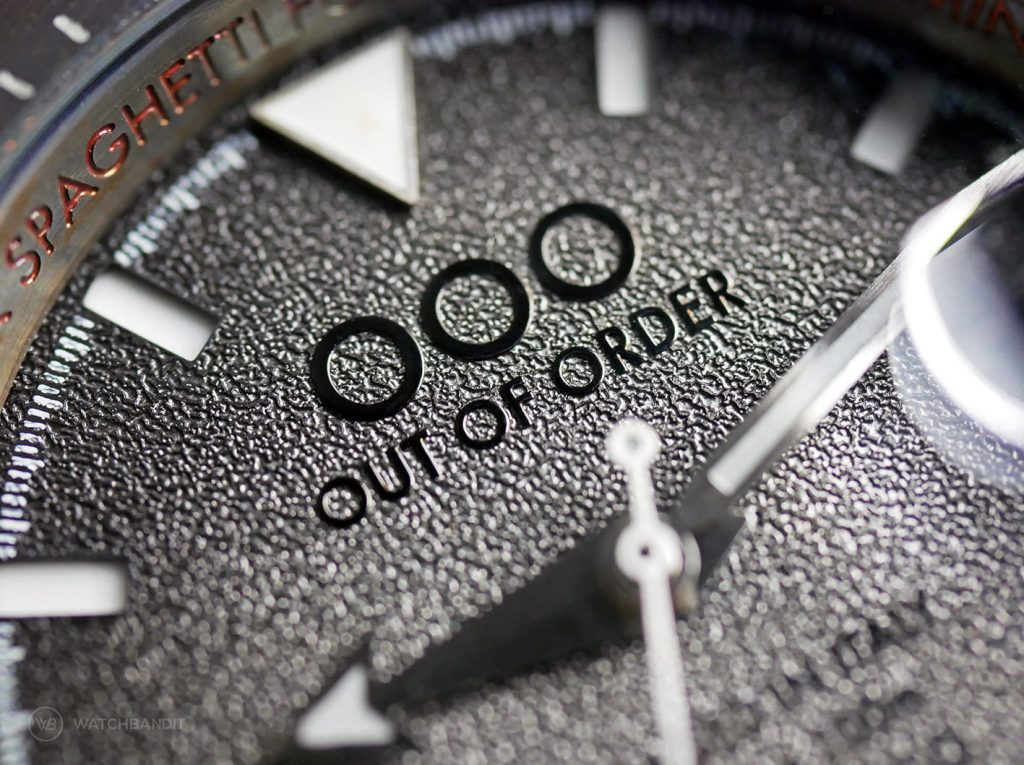 OOO Out Of Order Swiss Automatico dial close up macro