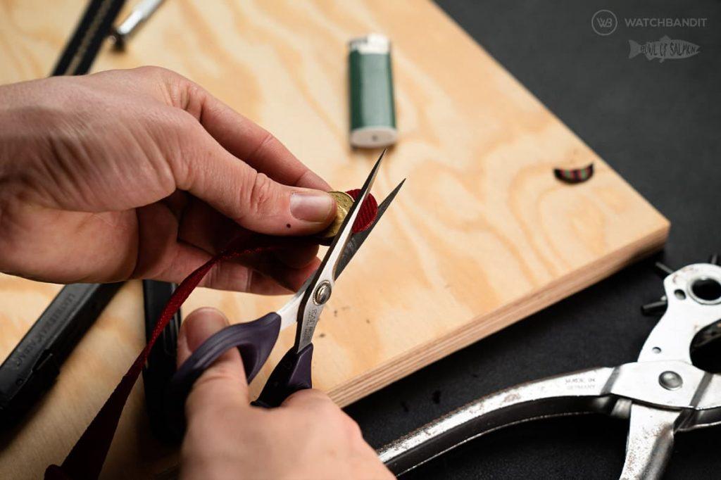 Cut the NATO strap with scissors