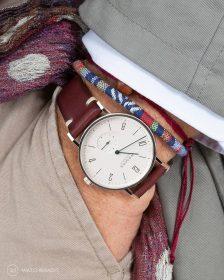 NOMOS Glashütte Tangente on burgundy vintage leather strap pocket shot